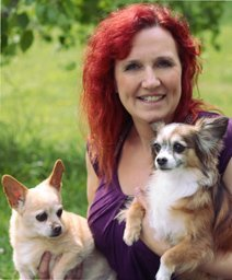 Team member Paula with her two pet dogs